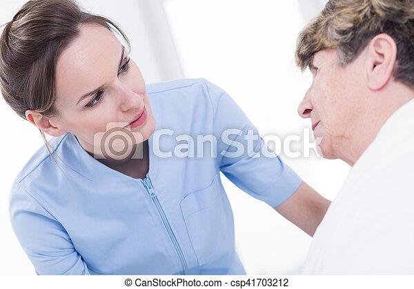 Female nurse with senior - csp41703212