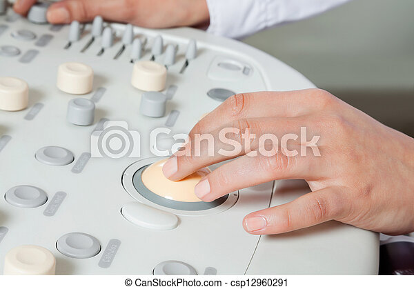 Female Radiologist Operating Ultrasound Machine - csp12960291