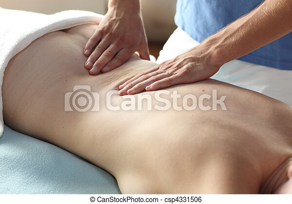female receiving back massage - clo - csp4331506