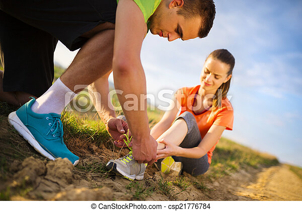 Female runner with twisted ankle - csp21776784