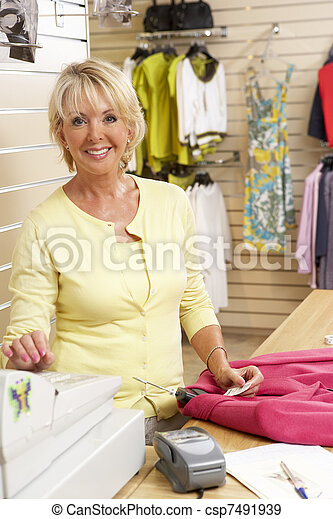 Female sales assistant in clothing store - csp7491939