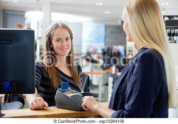 Female Sales Clerk At Counter - csp10264106