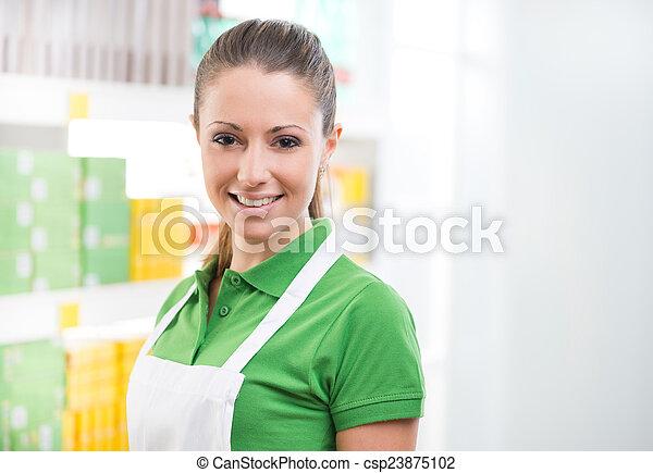 Female sales clerk working at supermarket - csp23875102
