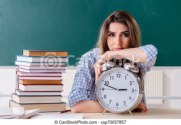 Female student in front of chalkboard - csp70037857
