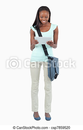 Female student reading her notes - csp7859520