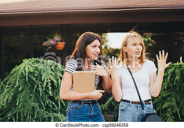 Female students look in surprise at the side