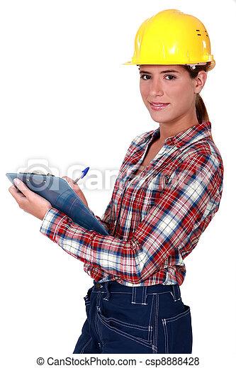 Female supervisor holding clipboard - csp8888428