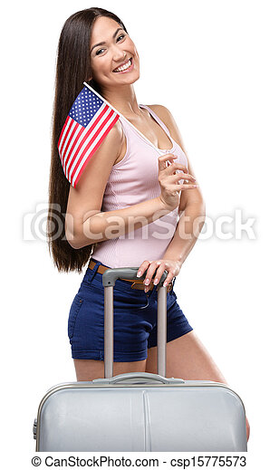 Female tourist with travel suitcase and USA flag - csp15775573
