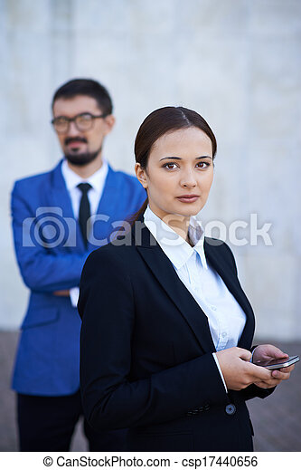 Female with cellular phone - csp17440656