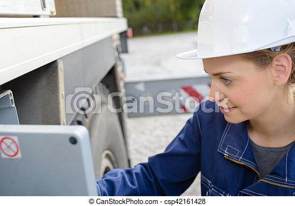 Female worker operating heavy goods vehicle - csp42161428