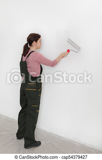 Female worker painting wall in a room - csp54379427
