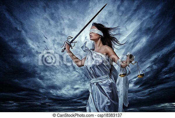Femida, Goddess of Justice, with scales and sword wearing blindfold against dramatic stormy sky - csp18383137