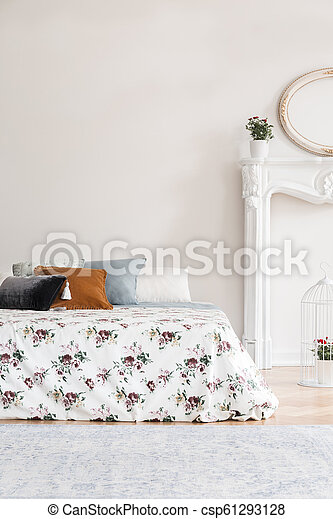 Feminine English Style Bedroom Interior With A Bed With Rose Pattern Cover And Multicolor Pillows Against An Empty Copy Space Wall Real Photo