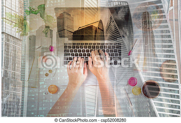 Feminine workspace - laptop, coffee and phone with someones hands typing, , double exposure with modern cityscape