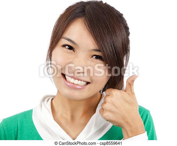 femme, pouce haut, jeune, asiatique, sourire - csp8559641
