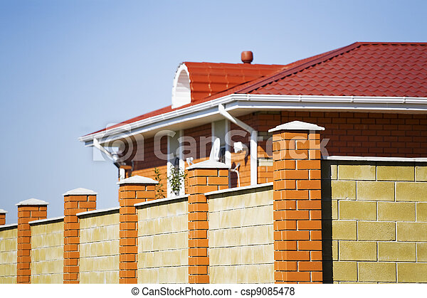 Fence and the modern house in suburban settlement - csp9085478