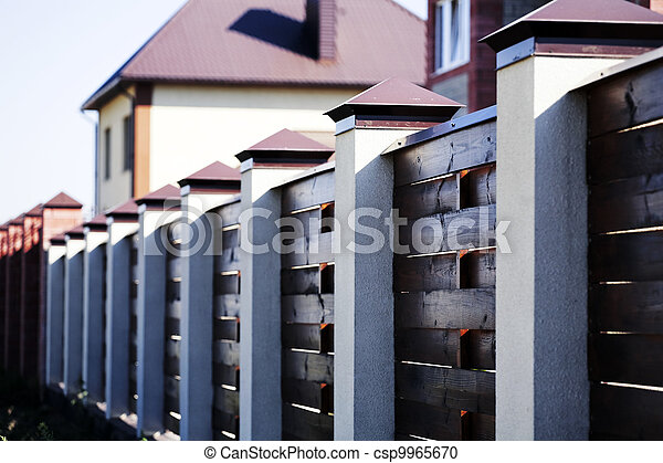 Fence and the modern house in suburban settlement - csp9965670