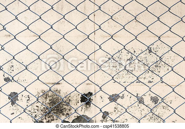 Fence from steel mesh on grunge cement wall backgroud - csp41538805