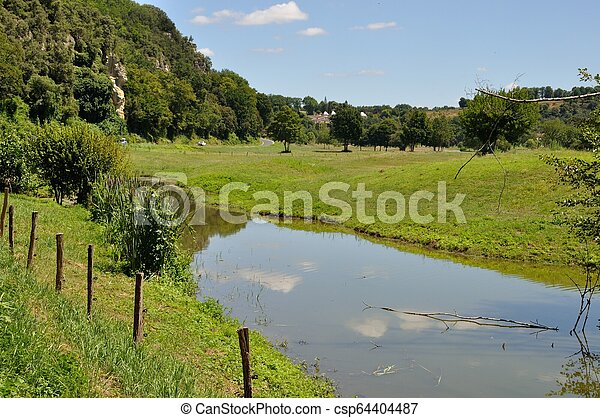 Fence in a meadow - csp64404487