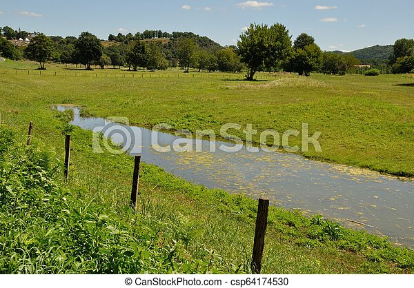 Fence in a meadow - csp64174530