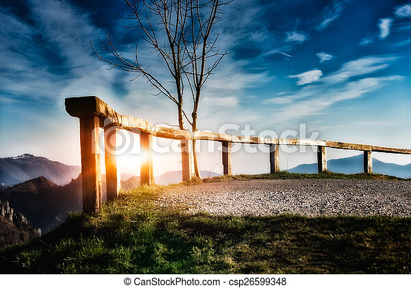Fence in the mountains at sunset - csp26599348