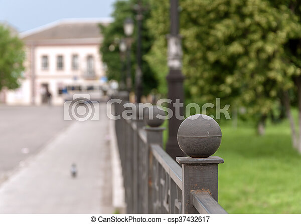 Fence of iron in the alley city - csp37432617