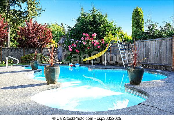 Fenced backyard with small beautiful swimming pool - csp38322629