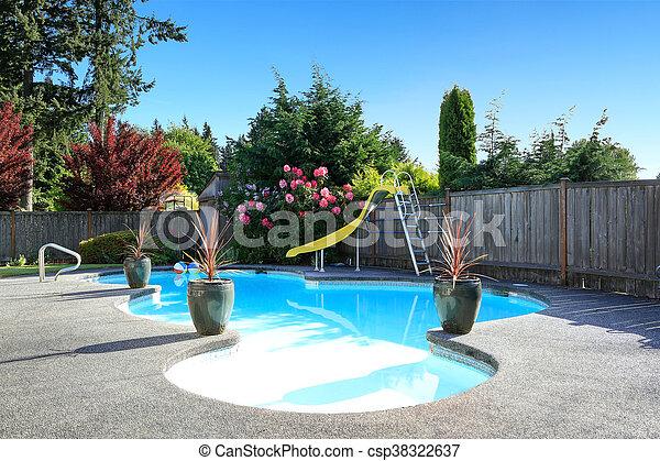 Fenced backyard with small beautiful swimming pool - csp38322637