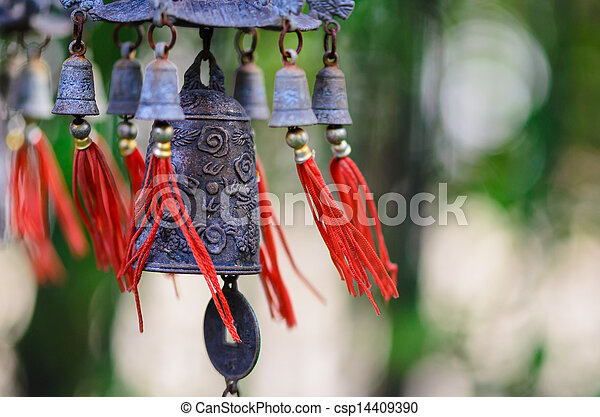 Feng Shui Chinese Bell and Coin being blown - csp14409390