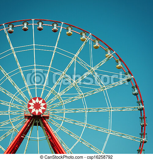 Ferris wheel attraction on blue sky background. - csp16258792