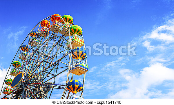 Ferris wheel on a background of sky. - csp81541740