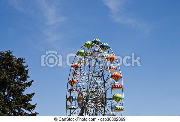 Ferris wheel on blue sky background - csp36802869