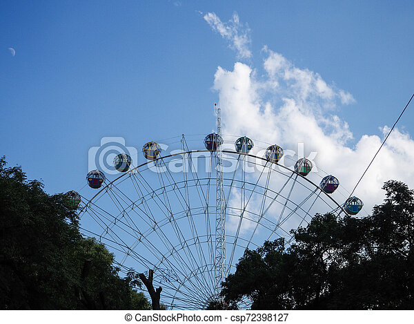 Ferris wheel on the background of blue sky - csp72398127