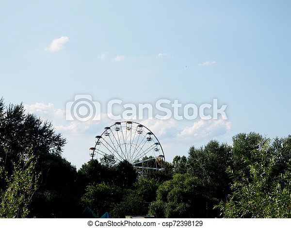 Ferris wheel on the background of blue sky - csp72398129