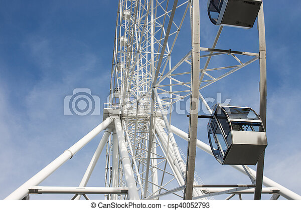 Ferris wheel on the background of blue sky - csp40052793