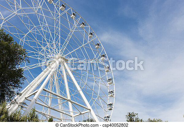 Ferris wheel on the background of blue sky - csp40052802