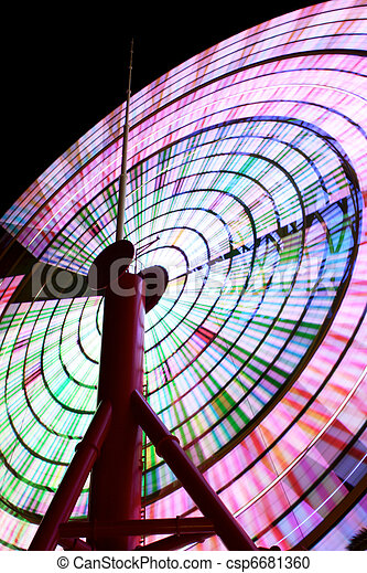 Ferris Wheel Spinning at Night 2 - csp6681360