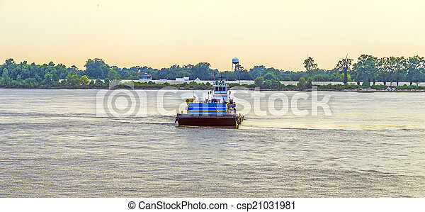 Ferry crossing Mississippi river at sunset in Baton Rouge - csp21031981
