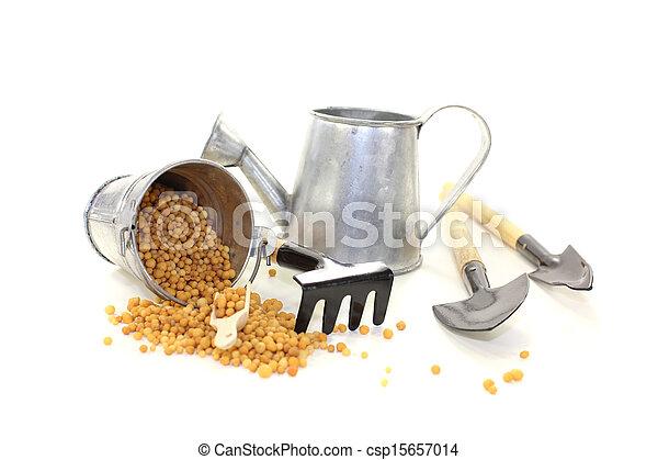 Fertilizer with garden tools - csp15657014