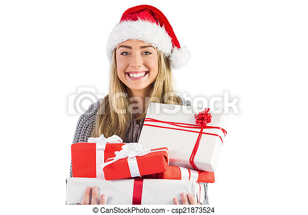Festive blonde holding pile of gifts - csp21873524