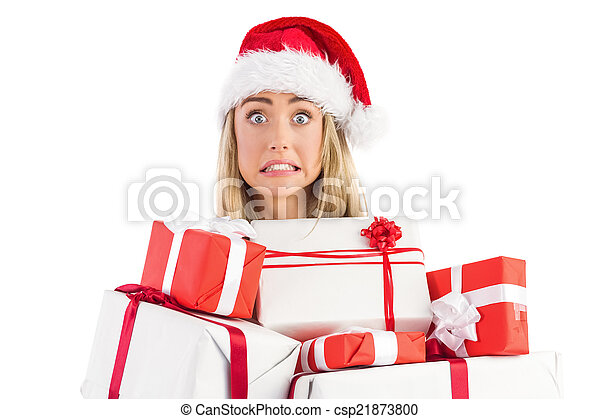 Festive blonde holding pile of gifts - csp21873800