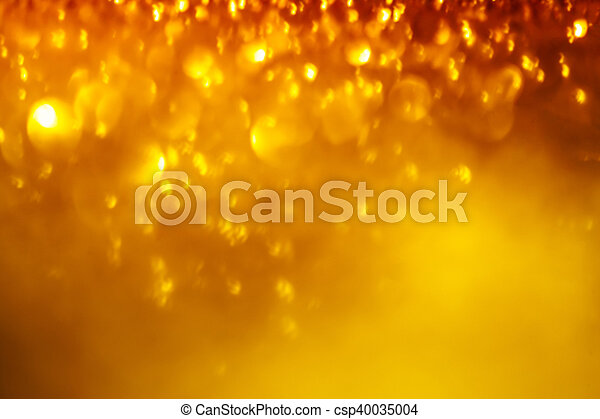 Festive blur background. Abstract twinkled bright background with bokeh defocused golden lights. Christmas blurry boke lights - csp40035004