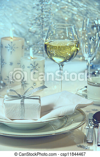 Festive dinner setting with gift for the holidays - csp11844467
