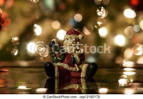 Festive santa with Christmas light background - csp12160179