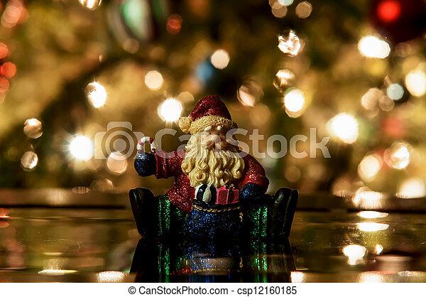 Festive santa with Christmas light background - csp12160185