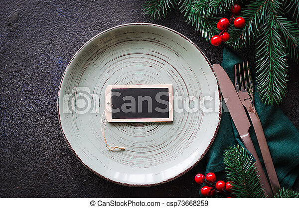 Festive table setting for Christmas or New Year dinner. - csp73668259
