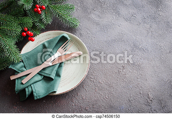 Festive table setting for Christmas or New Year dinner. - csp74506150