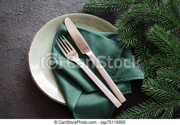 Festive table setting for Christmas or New Year dinner. - csp75116950