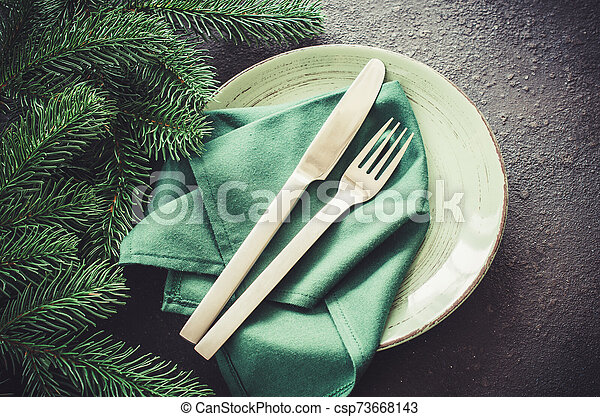 Festive table setting for Christmas or New Year dinner. - csp73668143