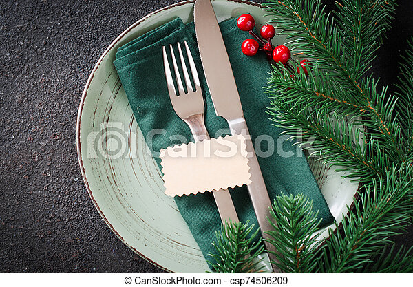 Festive table setting for Christmas or New Year dinner. - csp74506209